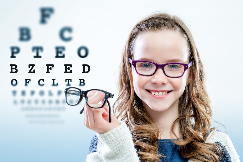 Child wearing glasses during vision test